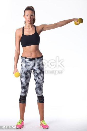 607622628 istock photo Sport girl doing her exercise. 889144066
