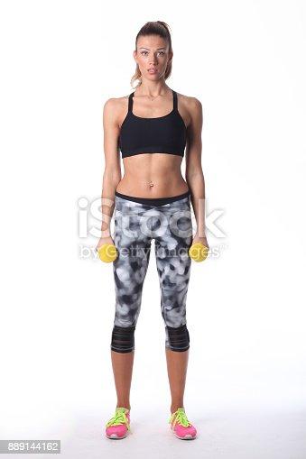607622628 istock photo Sport girl doing her exercise. 889144162