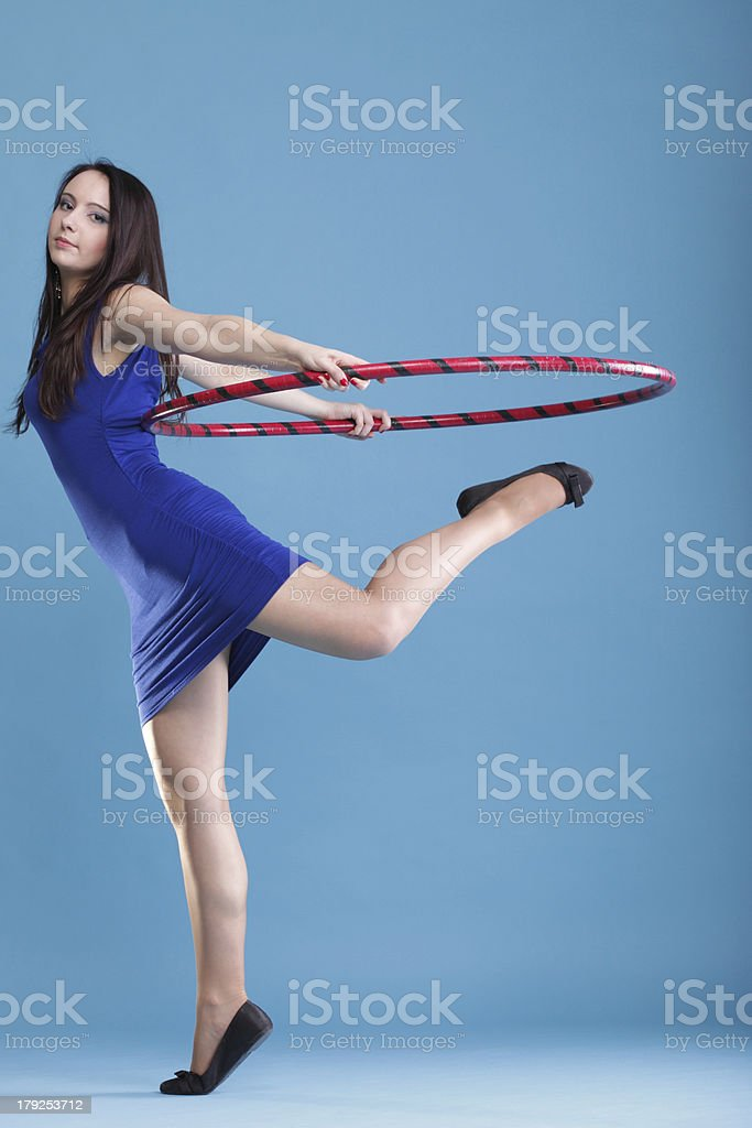 Sport girl fitness woman dancing with hula hoop royalty-free stock photo