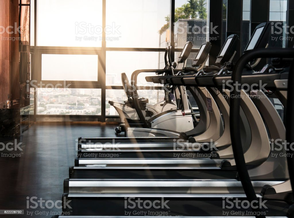 Sport gym interior with treadmill equipment in the morning stock photo
