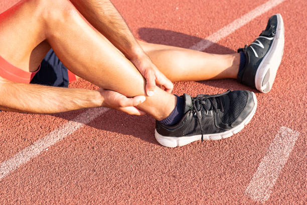 Sport injury, A man has ankle pain during outdoor exercise. knee Injuries stock photo