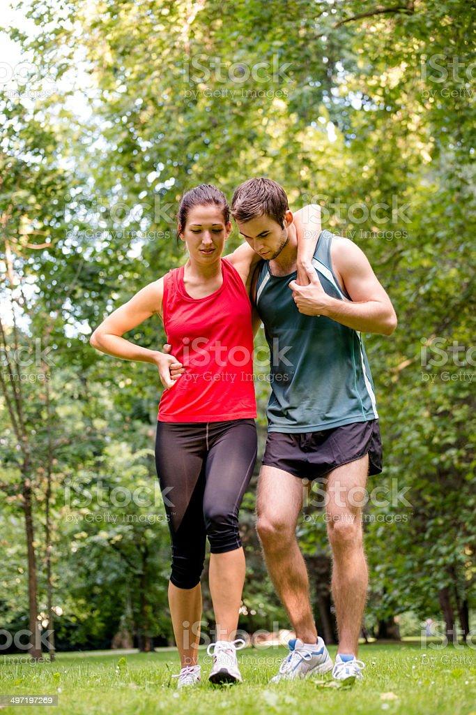 Sport injury - helping hand royalty-free stock photo