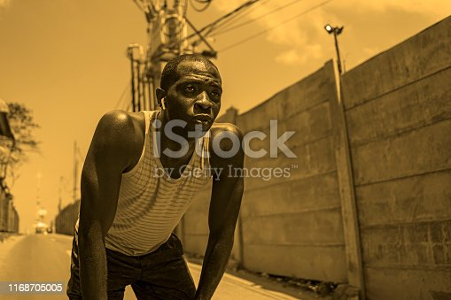 istock sport lifestyle portrait of tired and exhausted black badass looking black African American man breathing cooling off after hard running workout in fitness sacrifice and athlete training 1168705005