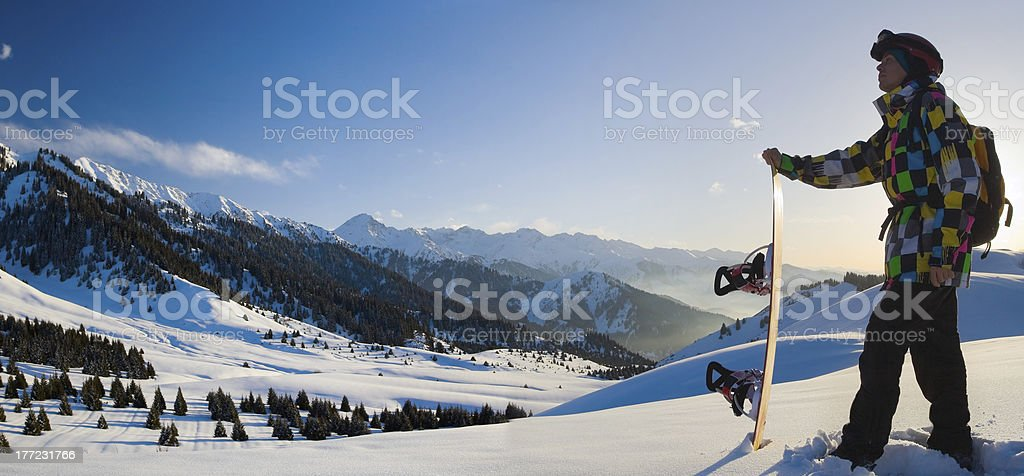 Sport man in snowy mountains at sunset royalty-free stock photo