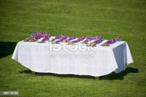 istock Sport medals on footbal field 188125292