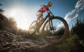 istock Sport. Mountain Bike cyclist riding single rock track. 826240462