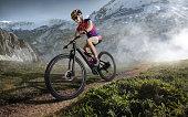 istock Sport. Mountain Bike cyclist riding single track. 826240390