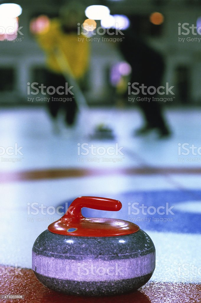 sport of curling in action stock photo