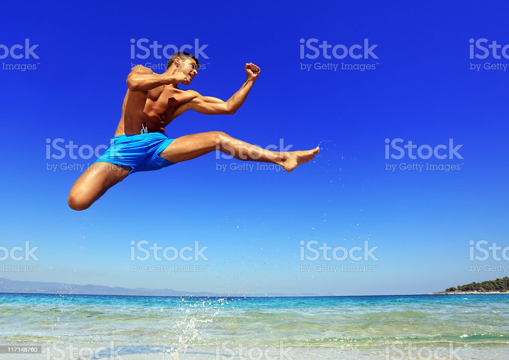 Sport on the beach, man having a training karate. royalty-free stock photo