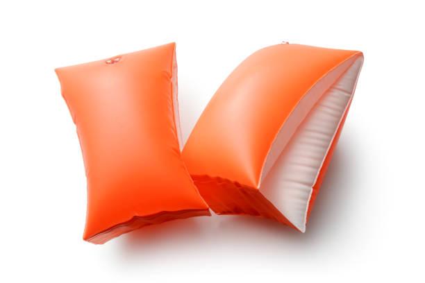 sport: orange schwimmflügel, isolated on white background - a zone armband stock-fotos und bilder