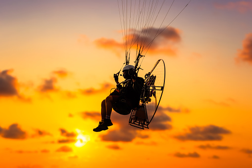 Sport paramotor over the sky at sunset and beautiful cloud.