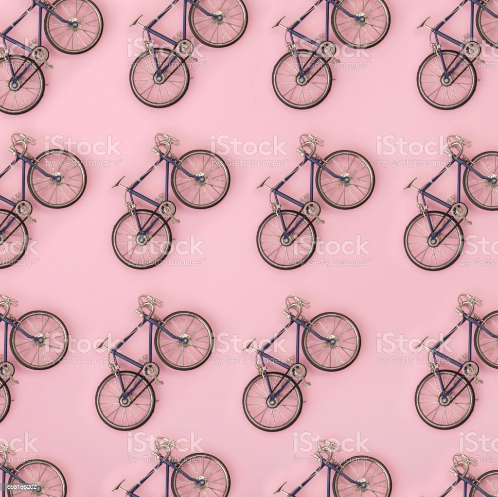Sport pattern - toy bicycles on pink background stock photo