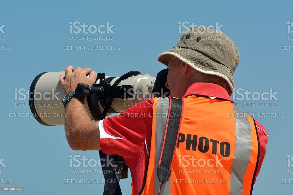 Sport photographers photographing stock photo