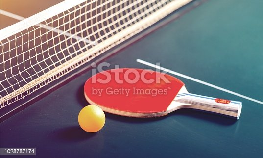 Table Tennis Rackets and Ball on Table with Net