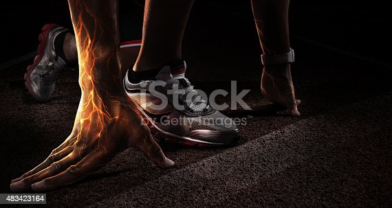 istock Sport. Runner. Hands on starting line. Fire and energy 483423164
