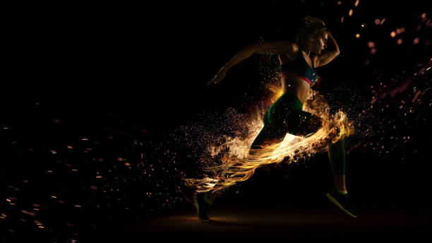 Sport. Runner. Side view of a jogger athlete with the power isolated on black. Fire and energy