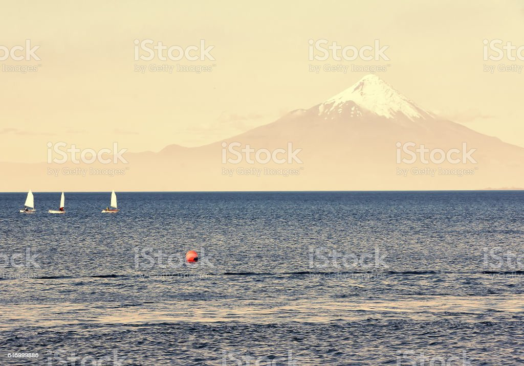 Sport sailing yachts  in regatta in the lake Llanquihue on the background of the volcano Osorno in  Chile, South America stock photo
