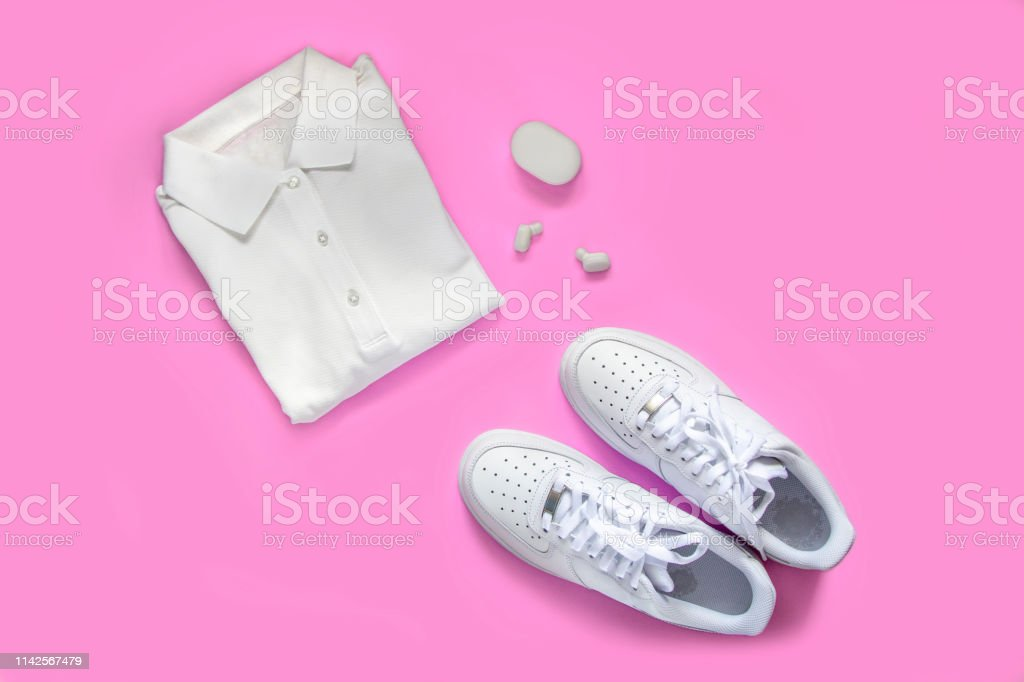 c44e42a6 Sport set, fitness accessories flat lay on pink background. White fashion  footwear, earphones