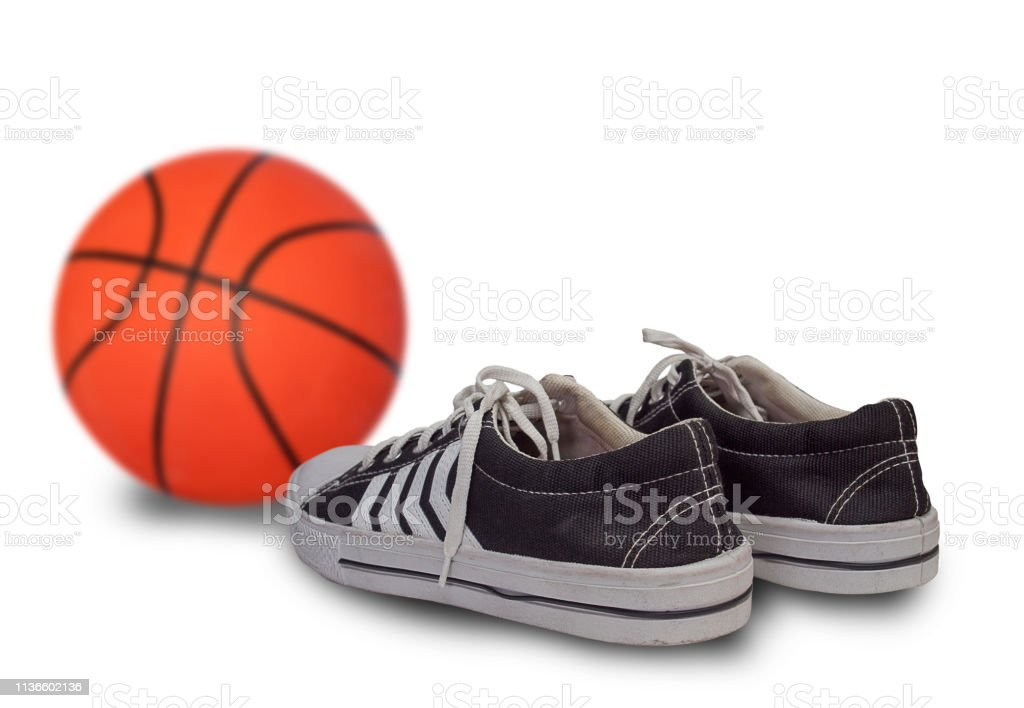 sport shoes and basketball ball.