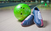 """istock Sport Shoes and green ball on floor in bowling club""""n 1141044631"""