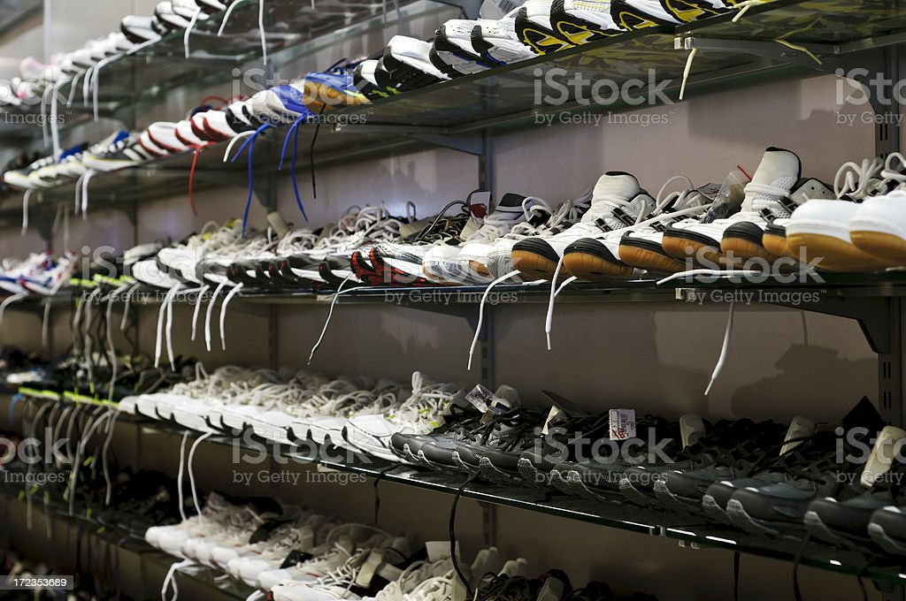 Sport shoes on the shelf royalty-free stock photo