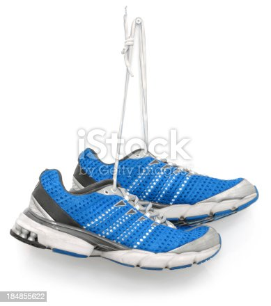 A pair of blue running shoes. Isolated on white.