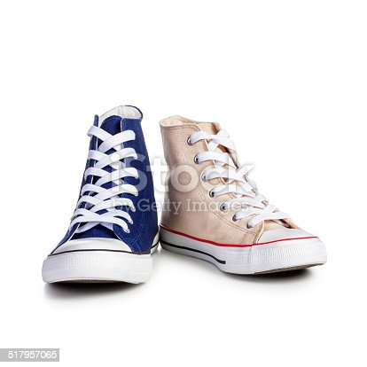 Male and female sport shoes isolated on white background. Togetherness concept. Objects with clipping path