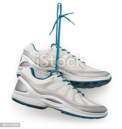 A pair of running shoes hanging from a hook.