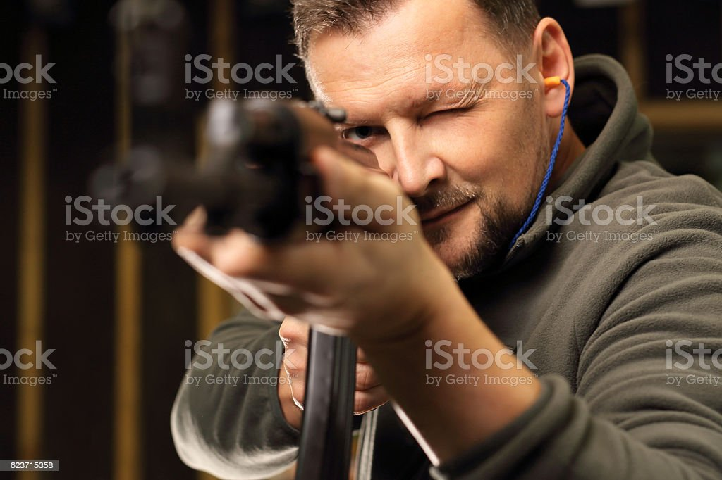 Sport shooting range. The man at the shooting range stock photo