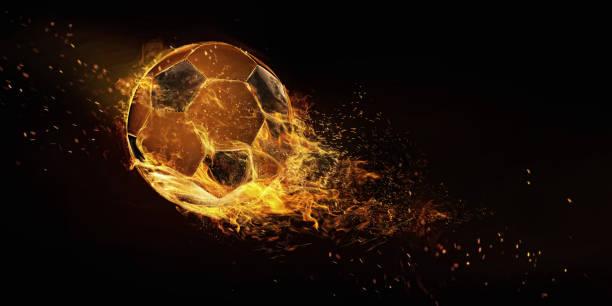 sport. fußball in nahaufnahme flammenbild. fußball auf schwarzem hintergrund isoliert. fußball-energie. - fußball poster stock-fotos und bilder