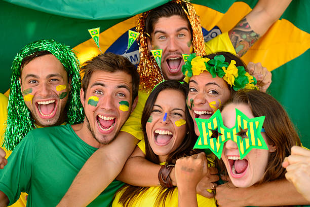 Sport soccer fans amazed celebrating victory together. stock photo