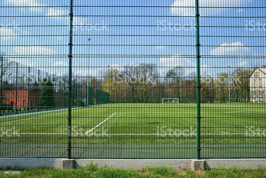 Sport, Soccer field behind the fence royalty-free stock photo