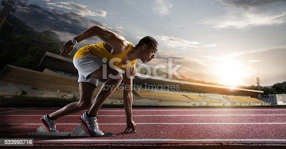 istock Sport. Sprinter leaving starting blocks on the running track. 533993716