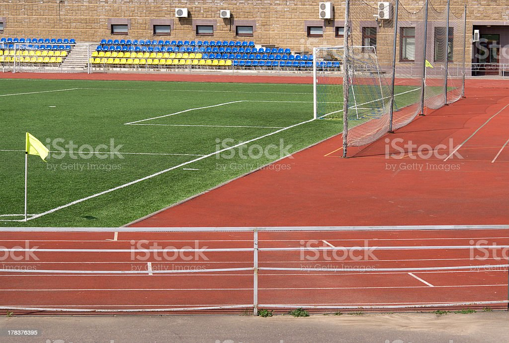 Sport stadium with football field and gate stock photo