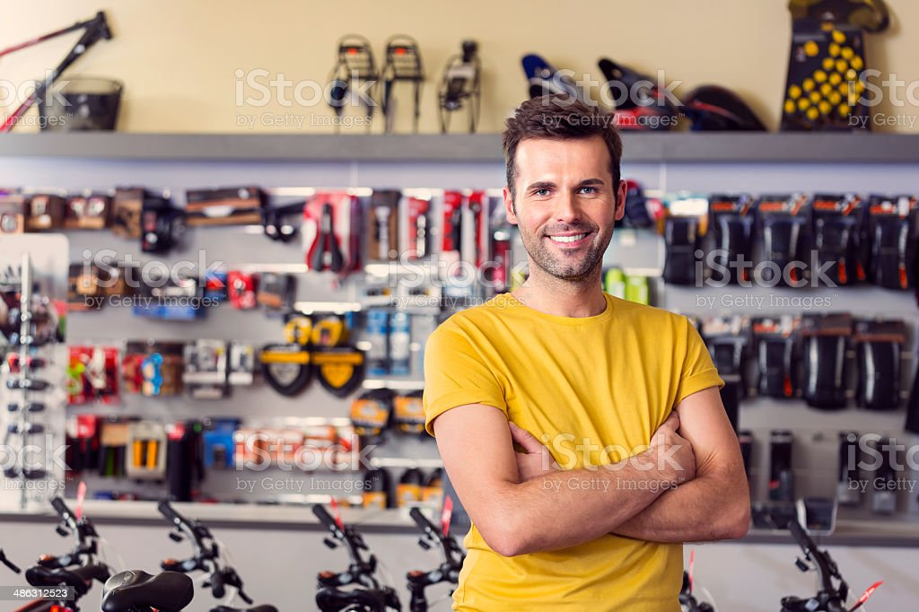 Sport store manager Portrait of manager of sports store, standing with arms crossed and smiling at camera. 30-34 Years Stock Photo