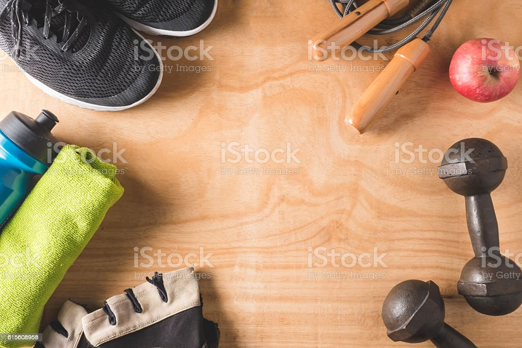 Sport stuff on wooden table background, Fitness lifestyle concept stock photo
