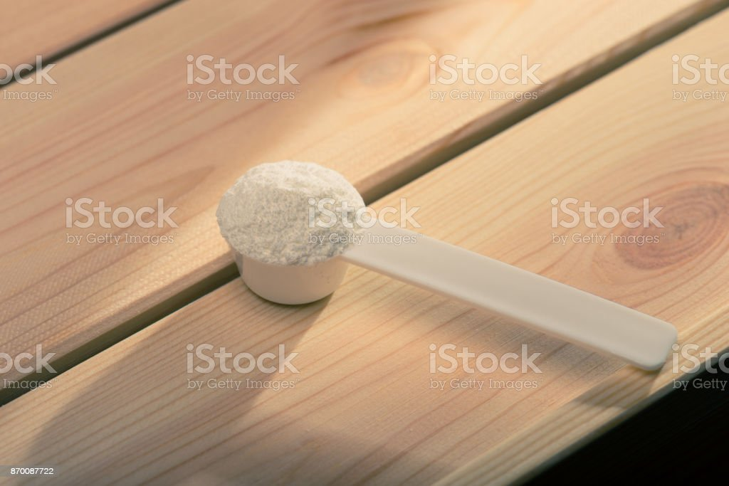 Sport supplement, creatine, hmb, bcaa, amino acid or vitamin mesure with powder. Sport nutrition concept. stock photo