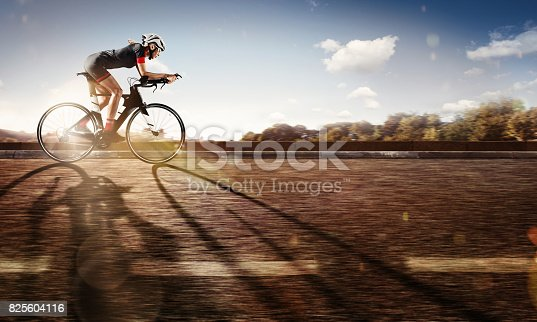 istock Sport. The cyclist rides on his bike at sunset. Dramatic background. 825604116