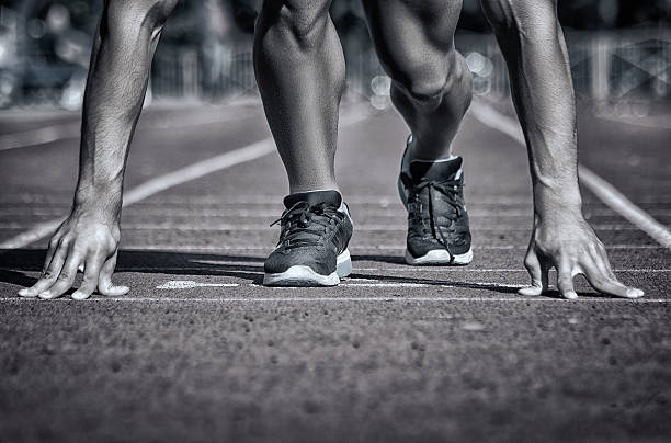 Sport. Unrecognizable runner on the starting stock photo