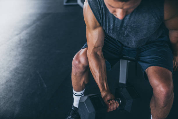 Sport. Unrecognizable strong athlete is going to do exercise Sport. Unrecognizable strong athlete is going to do exercise build muscles stock pictures, royalty-free photos & images