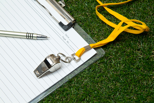Sport Whistle With Pen And Clipboard On Grass Stock Photo - Download Image Now