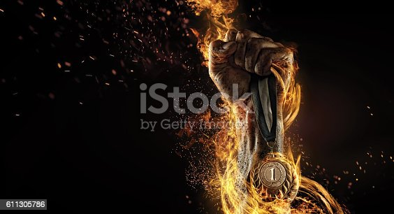istock Sport. Winner in a competition. Fire and energy 611305786