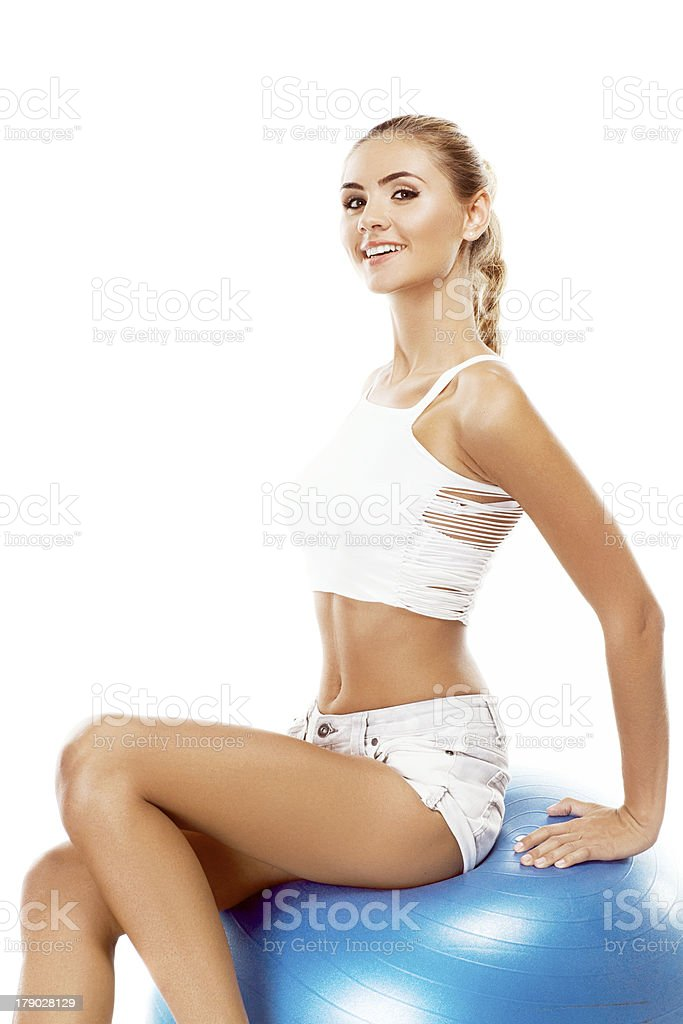 Sport woman in perfect shape . Concept - healthy lifestyles royalty-free stock photo