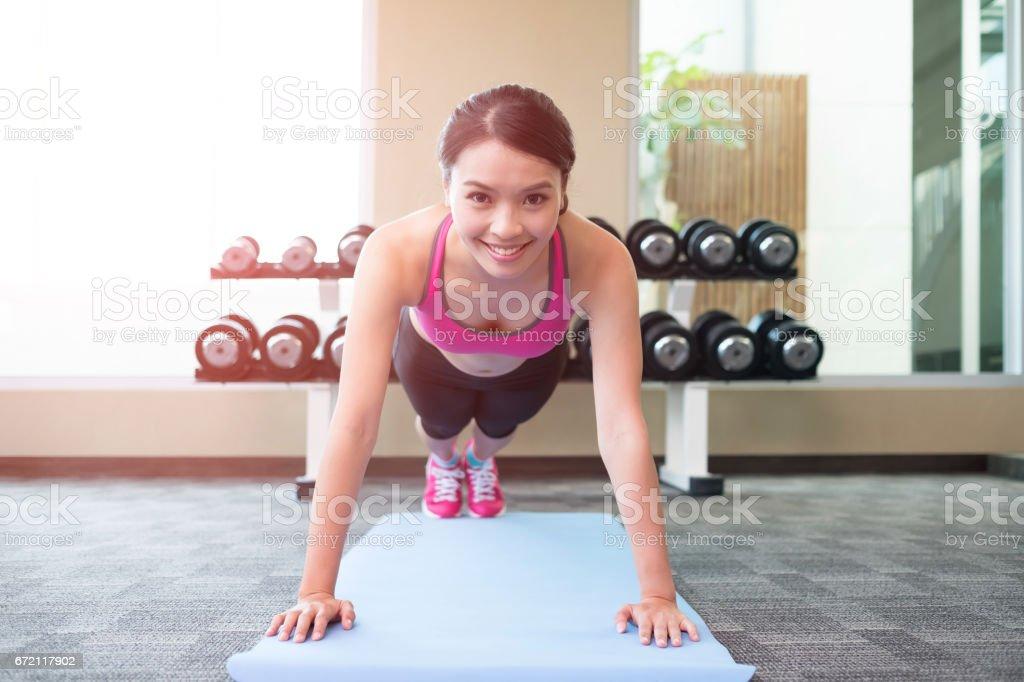 sport woman push-up stock photo