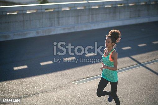 520047182 istock photo Sport woman running outdoors 653861354