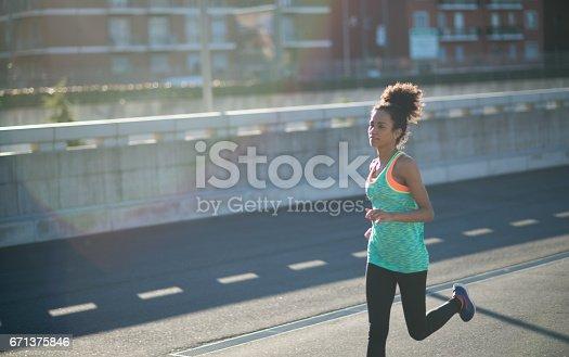 520047182 istock photo Sport woman running outdoors 671375846