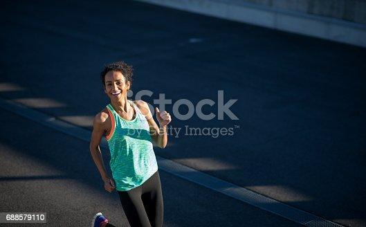 520047182 istock photo Sport woman running outdoors 688579110