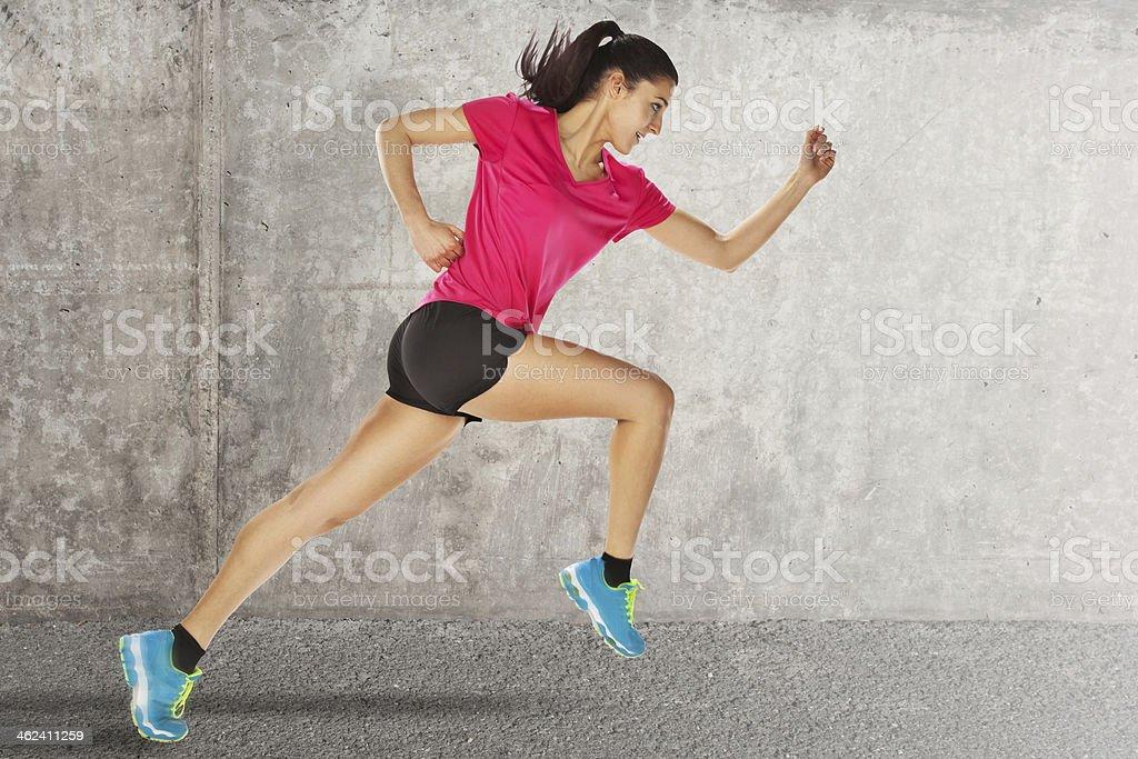 sport woman starting running stock photo