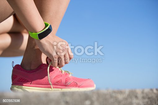 Health sport woman wearing smart watch device with touchscreen doing exercises