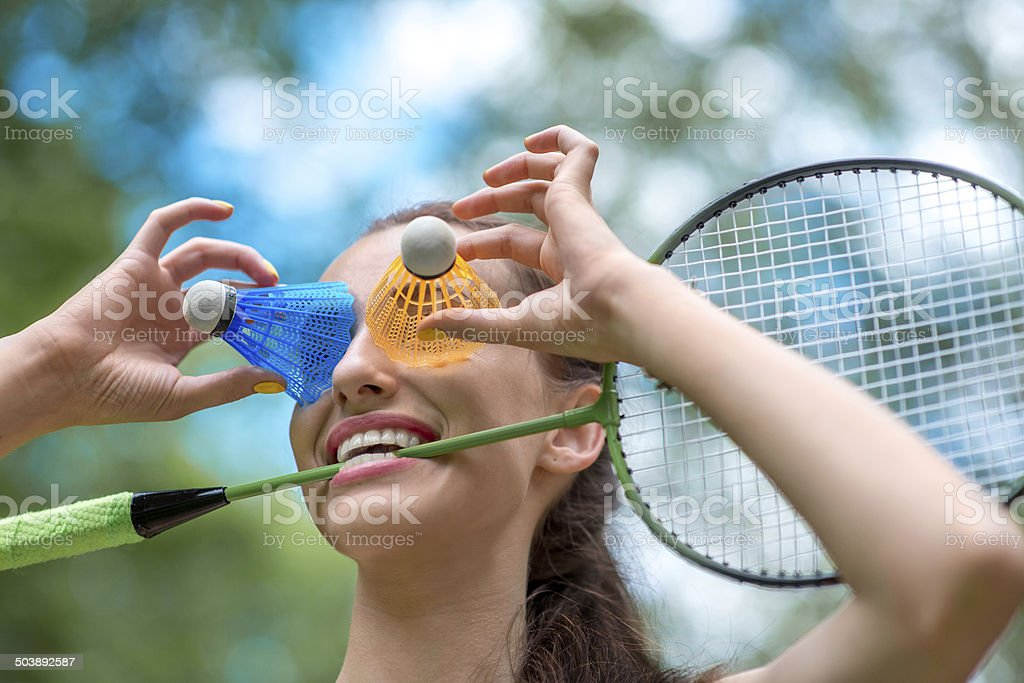 Sport woman with badminton racket and shuttlecock stock photo